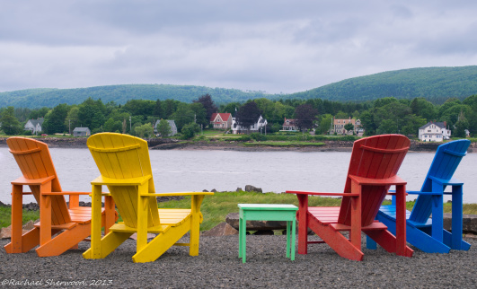 Annapolis Royal Nova Scotia rest area offering Adirondack chair seating and a view of the harbour